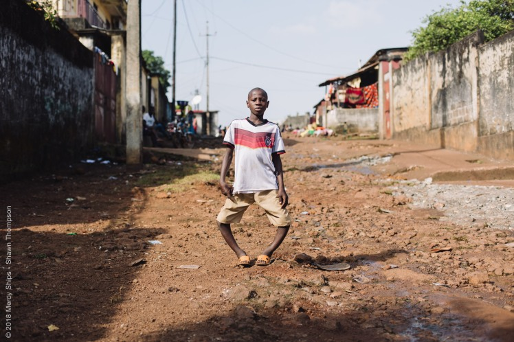Sema, orthopedic patient, in his neighborhood before surgery.
