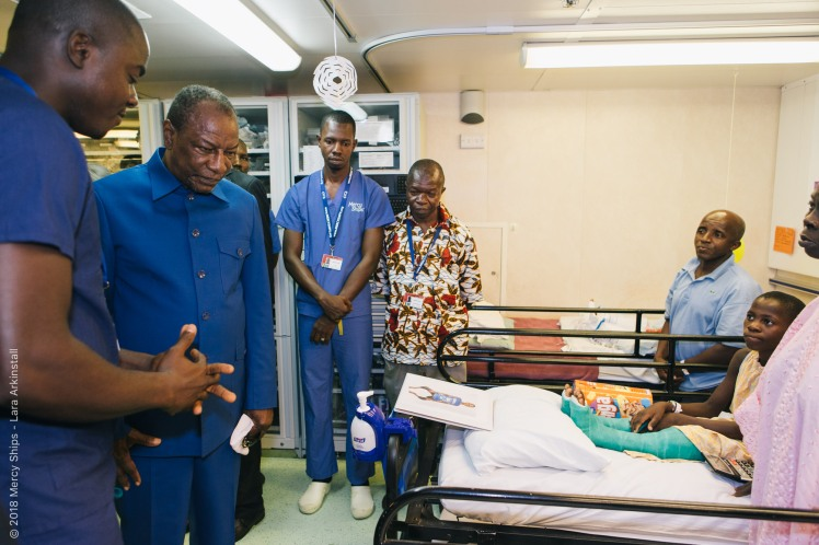 The President of Guinea, Alpha Conde, having a tour through the wards.