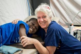 Outpatient nurse Rianne Van Wingerden with Mamadou in the outpatient tent.