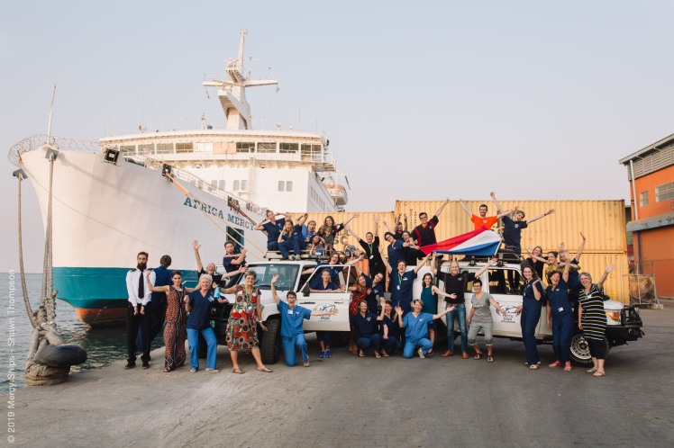 All of the Dutch crew members together in front of the ship.