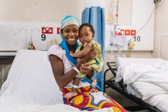 Aissata, cleft lip patient, in the ward after surgery with her mother.