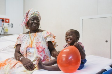 Cleft lip patient, Saliou, in the wards with his grandmother before his surgery.